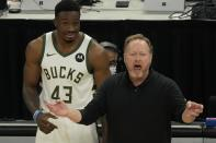 Milwaukee Bucks head coach Mike Budenholzer reacts to a call in front of Thanasis Antetokounmpo during the second half of Game 2 of the NBA Eastern Conference basketball finals game against the Atlanta Hawks Friday, June 25, 2021, in Milwaukee. (AP Photo/Morry Gash)