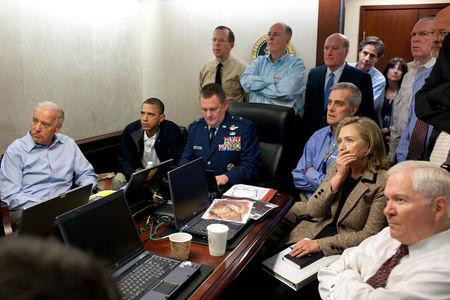 U.S. President Barack Obama (2nd L) and Vice President Joe Biden (L), along with members of the national security team, receive an update on the mission against Osama bin Laden in the Situation Room of the White House, May 1, 2011. Also pictured are Secretary of State Hillary Clinton (2nd R) and Defense Secretary Robert Gates (R). Please note: A classified document seen in this photograph has been obscured at source. Picture taken May 1, 2011.  REUTERS/White House/Pete Souza/Handout