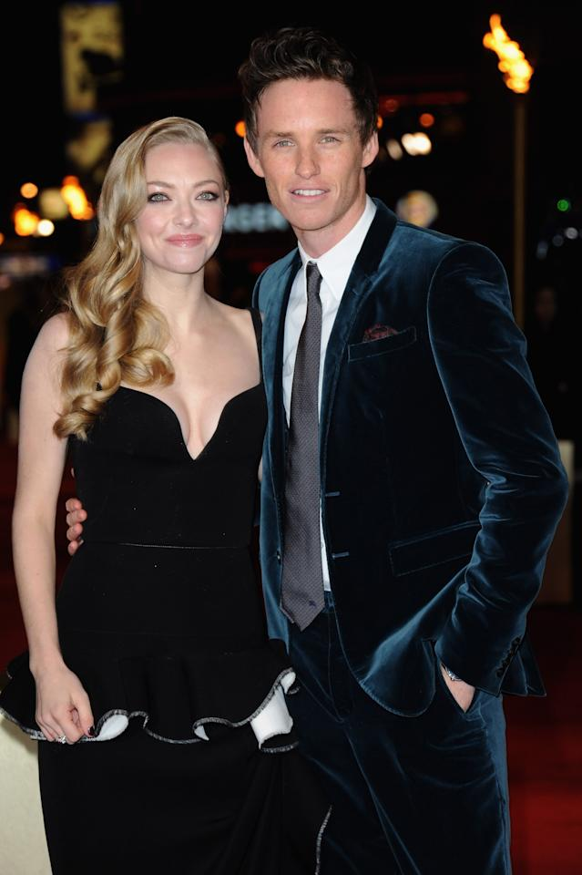 """LONDON, ENGLAND - DECEMBER 05:  Actors Amanda Seyfried and Eddie Redmayne attend the """"Les Miserables"""" World Premiere at the Odeon Leicester Square on December 5, 2012 in London, England.  (Photo by Stuart Wilson/Getty Images)"""