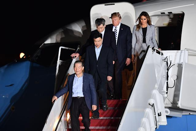 <p>President Donald Trump (2nd R) and his wife Melania Trump (R) walk down the stairs with U.S. detainees Tony Kim (2nd L), Kim Dong-chul (bottom L) and Kim Hak-song (C) upon their return after they were freed by North Korea, at Joint Base Andrews in Maryland on May 10, 2018. (Photo: Nicholas Kamm/AFP/Getty Images) </p>