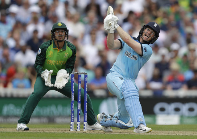 England's captain Eoin Morgan plays a shot for six off the bowling of South Africa's Aiden Markram during the World Cup cricket match between England and South Africa at The Oval in London, Thursday, May 30, 2019. (AP Photo/Kirsty Wigglesworth)