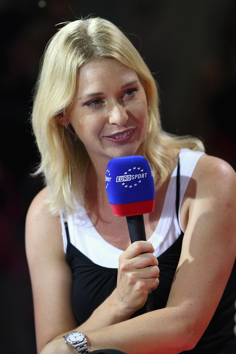 Barbara Schett smiling and answering questions during a live panel.