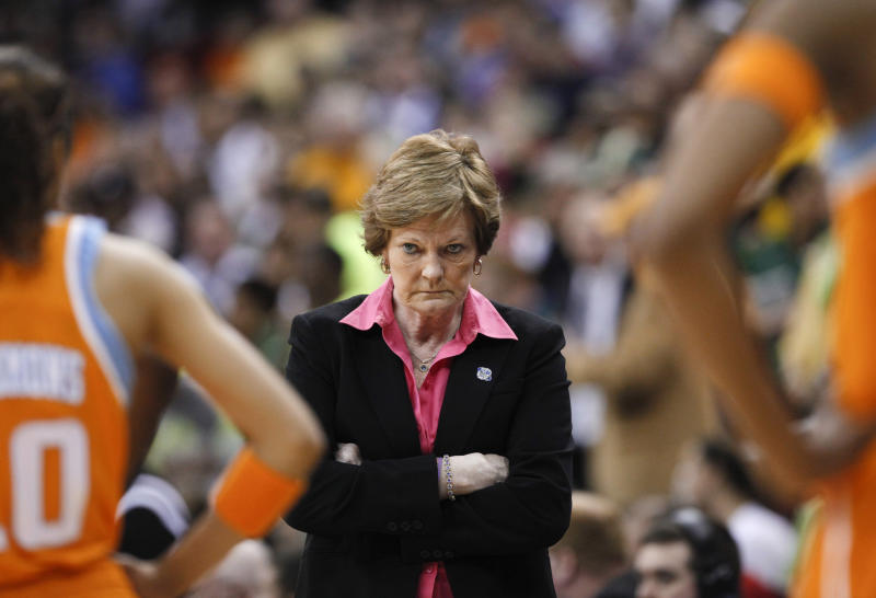 """FILE - In this March 26, 2012 file photo, Tennessee coach Pat Summitt waits for her players during a timeout in the second half of an NCAA women's college basketball tournament regional final against Baylor in Des Moines, Iowa. has an agreement with Crown Archetype, an imprint of Random House Inc., for a memoir that is currently untitled. According to Crown, which announced the deal Tuesday, the book will cover her """"full life journey,"""" including her diagnosis last year of early-onset dementia, Alzheimer's type. Publication is expected in spring 2013. (AP Photo/Nati Harnik, file)"""