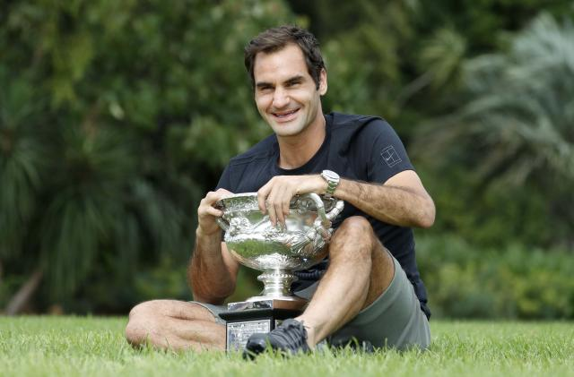 Tennis - Australian Open - Melbourne, Australia, January 29, 2018. Roger Federer of Switzerland poses with the men's singles trophy during the winner's photoshoot at the government house in Melbourne, Australia. REUTERS/Issei Kato TPX IMAGES OF THE DAY
