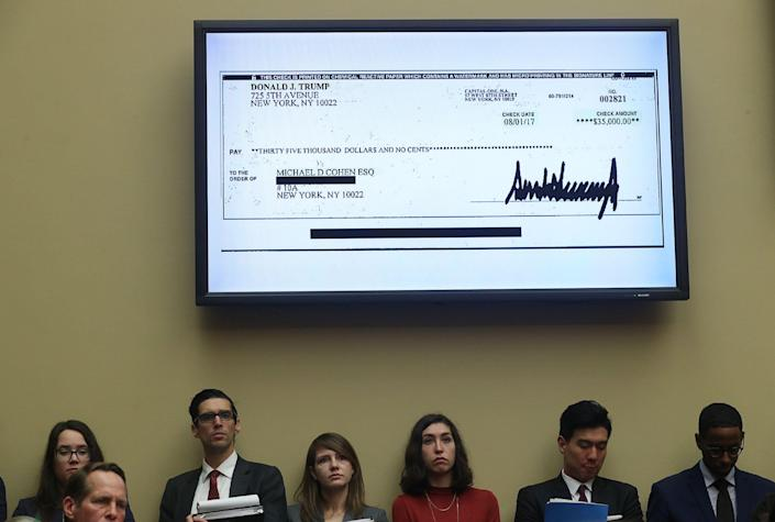 A $35,000 check signed by President Trump to Michael Cohen, his former personal attorney, is shown on a television monitor inside the hearing room as Cohen testifies on Capitol Hill in Washington, D.C., Feb. 27, 2019. (Jonathan Ernst/Reuters)
