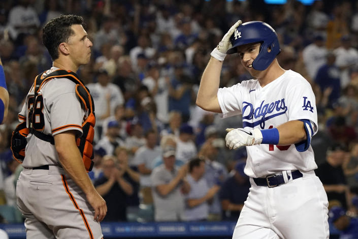 Los Angeles Dodgers' Will Smith, right, celebrates at home plate next to San Francisco Giants catcher Buster Posey after Smith's two-run home run during the fourth inning of a baseball game Thursday, July 22, 2021, in Los Angeles. (AP Photo/Marcio Jose Sanchez)