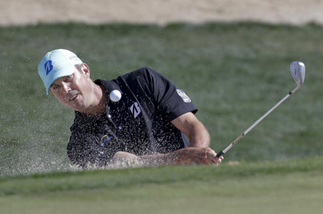 Matt Kuchar hits out of a bunker on the fifth hole in his match against Ryan Moore, during the second round of the Match Play Championship golf tournament on Thursday, Feb. 20, 2014, in Marana, Ariz. (AP Photo/Ted S. Warren)