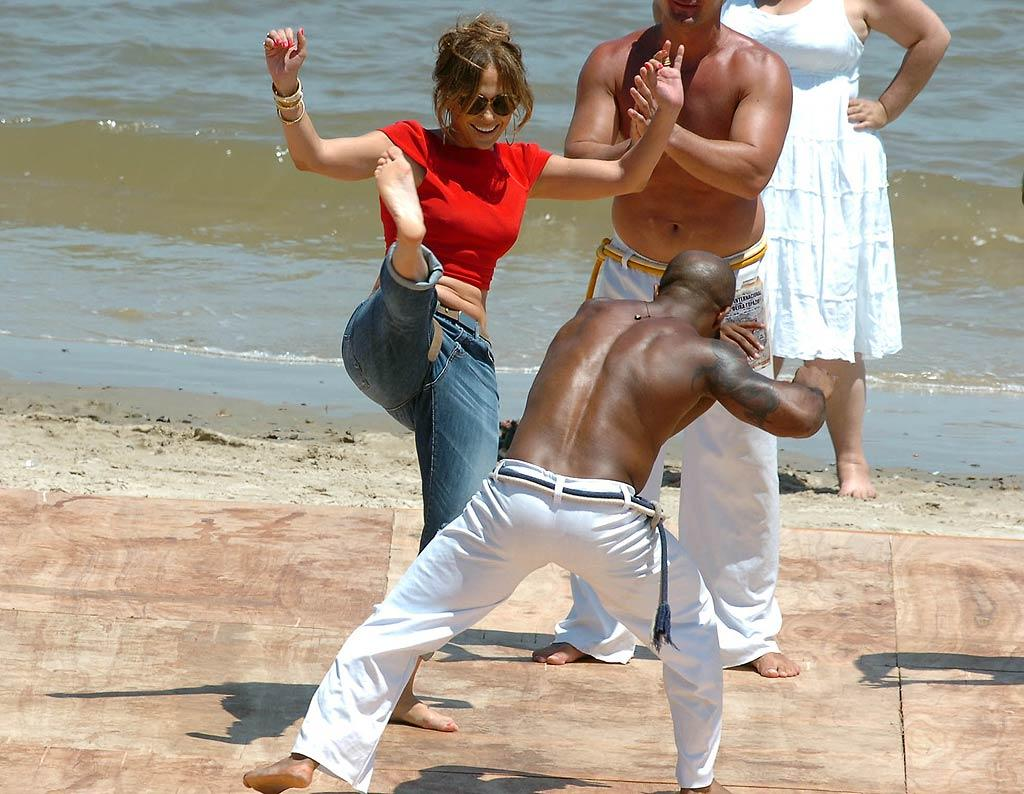 "Hi-yah! Jennifer Lopez showed off her martial arts skills at Playa de los Ingleses in Uruguay while shooting her new talent search show ""Q'Viva."" So what if she wasn't exactly dressed for the occasion? (12/8/2011)"