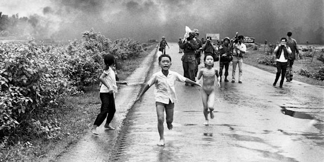 Vietnamese children flee from their homes in the South Vietnamese village of Trang Bang after planes dropped a napalm bomb on the village, located 26 miles outside of Saigon. 25 years later, the young girl running naked from her village, Phan Thi Kim Phuc, was named UNESCO goodwill ambassador. Photo: Bettmann/Contributor/Getty Images