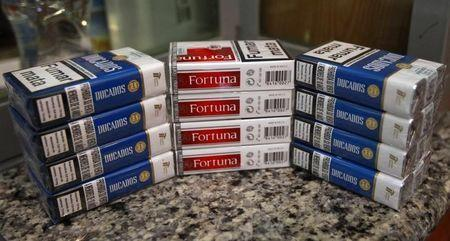 Cigarette packs of Imperial Tobacco are pictured at a tobacco store in Madrid