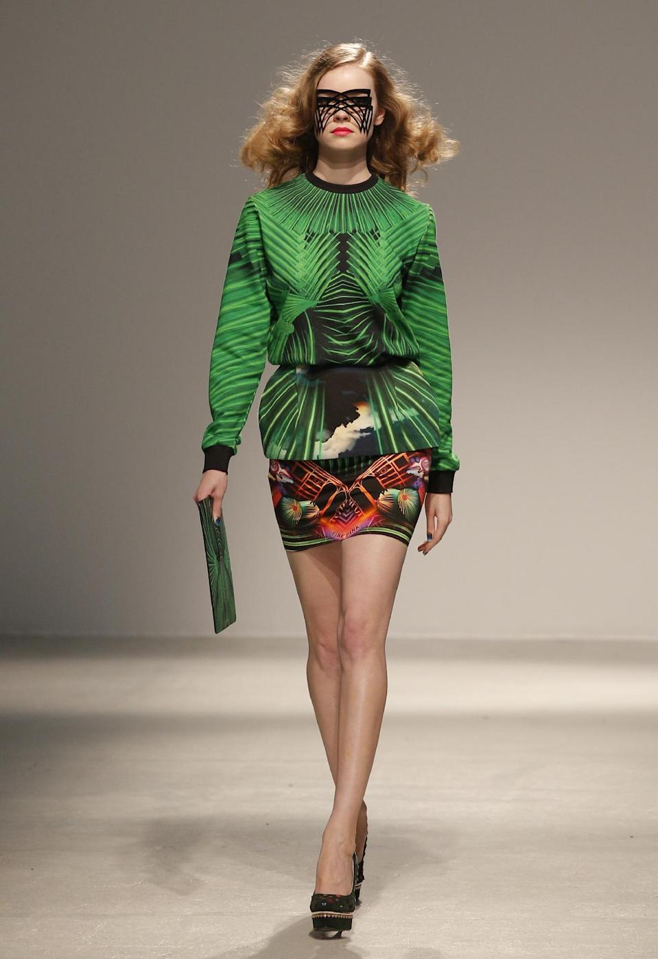 A model presents a creation by Indian fashion designer Manish Arora fior his Ready to Wear's Fall-Winter 2013-2014 fashion collection, presented Thursday, Feb.28, 2013 in Paris. (AP Photo/Christophe Ena)