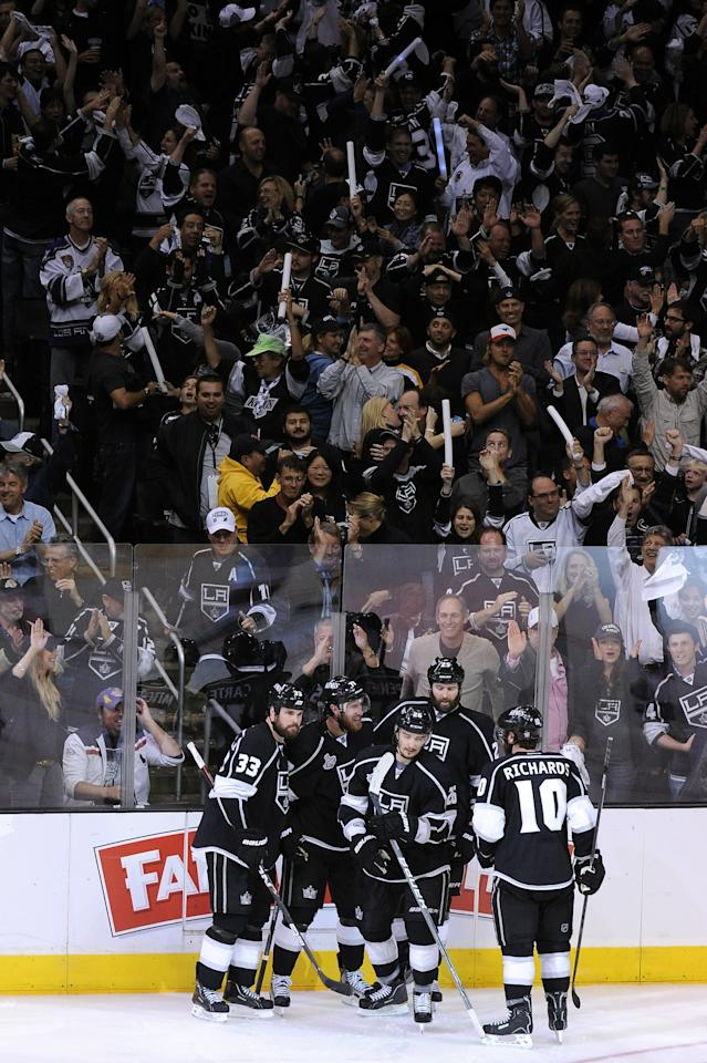 LOS ANGELES, CA - JUNE 04:  (L-R) Willie Mitchell #33, Jeff Carter #77, Slava Voynov #26, Dustin Penner #25 and Mike Richards #10 of the Los Angeles Kings celebrate Carter's goal in the third period against the New Jersey Devils in Game Three of the 2012 Stanley Cup Final at Staples Center on June 4, 2012 in Los Angeles, California.  (Photo by Jeff Gross/Getty Images)