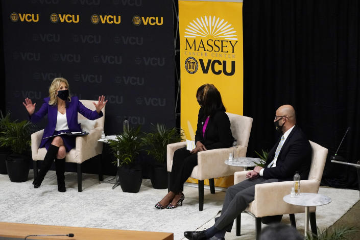 First lady Jill Biden, left, speaks during a forum at the Massey Cancer center at Virginia Commonwealth University for a discussion about cancer disparities. in Richmond, Va., Wednesday, Feb. 24, 2021. (AP Photo/Steve Helber)