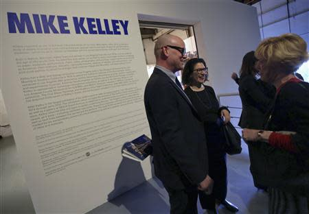MOCA Curator Bennett Simpson (L) greets visitors during a media preview of an exhibition of work by the late artist Mike Kelley at The Geffen Contemporary at The Museum of Contemporary Art (MOCA) in Los Angeles, California March 28, 2014. REUTERS/Jonathan Alcorn