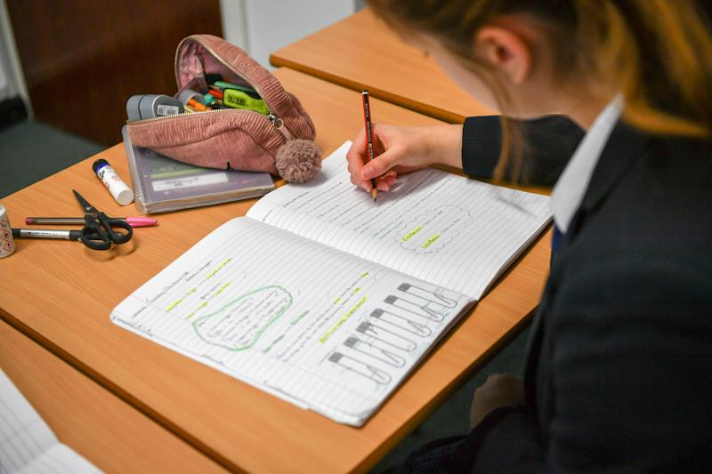 Students study and write in their exercise books in class at Royal High School Bath, which is a day and boarding school for girls aged 3-18 and also part of The Girls' Day School Trust, the leading network of independent girls' schools in the UK. (Photo by Ben Birchall/PA Images via Getty Images)