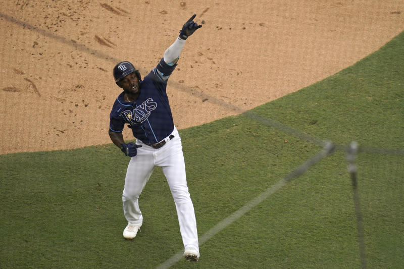 Tampa Bay Rays' Randy Arozarena reacts after crossing the plate after hitting a solo home run during the first inning in Game 2 of a baseball American League Division Series against the New York Yankees, Tuesday, Oct. 6, 2020, in San Diego. (AP Photo/Gregory Bull)