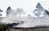 Frequent rocket attacks on the Turkish border town of Kilis have prompted Turkey's army to respond with howitzer fire (AFP Photo/Bulent Kilic)
