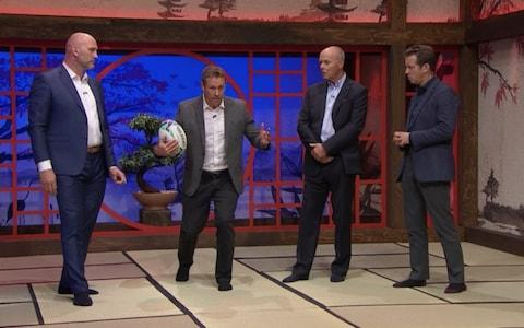 Wilkinson, Sir Clive Woodward, Lawrence Dallaglio, the ex-England captain, and presenter Craig Doyle in socks - Credit: ITV
