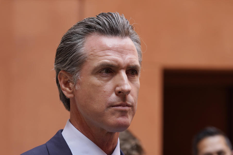"""California Gov. Gavin Newsom listens to a question while meeting with reporters after casting his recall ballot at a voting center in Sacramento, Calif., Friday, Sept. 10, 2021. The last day to vote in the recall election is Tuesday Sept. 14. A majority of voters must mark """"no"""" on the recall to keep Newsom in office. (AP Photo/Rich Pedroncelli)"""