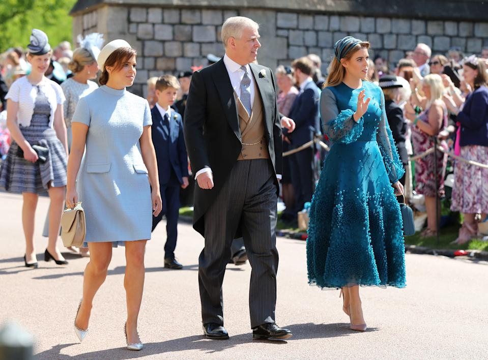 Princess Eugenie, Prince Andrew, Duke of York and Princess Beatrice arrive at St George's Chapel at Windsor Castle before the wedding of Prince Harry to Meghan Markle on May 19, 2018 in Windsor, England.