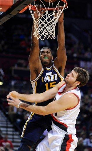 Utah Jazz's Derrick Favors (15) bounces the ball off the rim against Portland Trail Blazers' Joel Freeland (19) during the first half of an NBA preseason basketball game in Portland, Ore., Monday, Oct., 22, 2012. (AP Photo/Greg Wahl-Stephens)