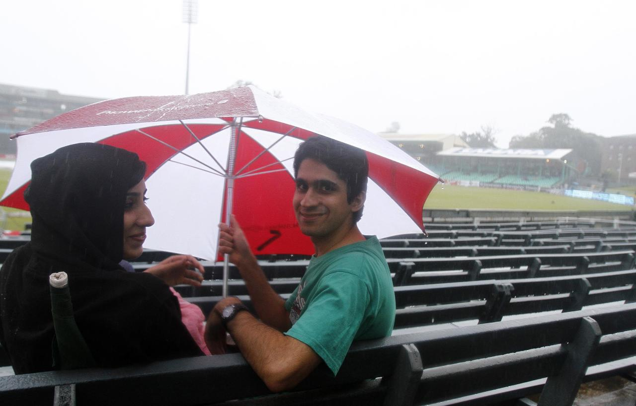 Fans braved the rain on March 1, 2013  at Sahara Stadium in Durban, South Africa. Steady rain threatened to wash out the first Twenty20 international between South Africa and Pakistan at Kingsmead here on Friday. AFP PHOTO / STRINGER        (Photo credit should read STRINGER/AFP/Getty Images)
