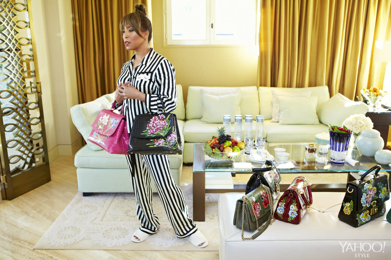 """<p>Harvey tests out Dolce and Gabbana bags in her Amanda Fatherazi x Morgan Lane silk pajamas.<i>Photo: <a href=""""http://hugueslaurent.fr/"""">Hugues Laurent</a></i></p>"""