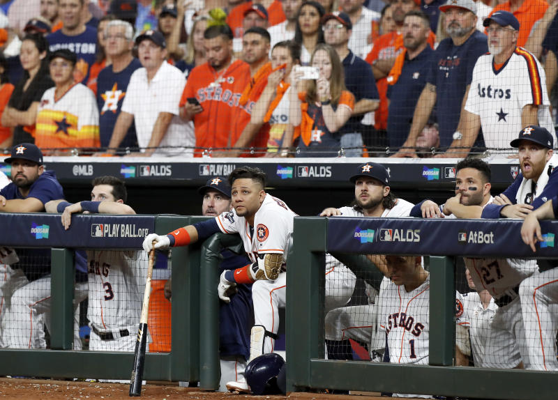 HOUSTON, TX - OCTOBER 10: Yuli Gurriel #10 of the Houston Astros watches from the dugout in the eighth inning against the Tampa Bay Rays at Minute Maid Park on October 10, 2019 in Houston, Texas. (Photo by Tim Warner/Getty Images)