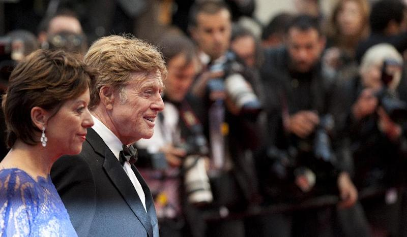 Actor Robert Redford, right, and his wife Sibylle Szaggars arrive for the screening of All Is Lost at the 66th international film festival, in Cannes, southern France, Wednesday, May 22, 2013. (AP Photo/Virginia Mayo)