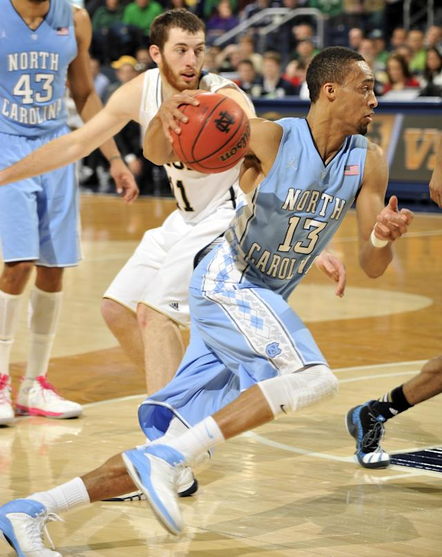 North Carolina forward J.P. Tokoto drives the lane as Notre Dame forward Garrick Sherman defends during the second half of an NCAA college basketball game Saturday, Feb. 8, 2014, in South Bend, Ind. (AP Photo/Joe Raymond)