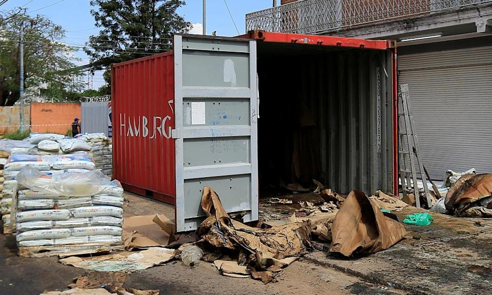 A container where authorities found decomposed bodies inside a fertiliser shipment that left Serbia three months earlier is seen in Asunción, Paraguay, on 23 October.