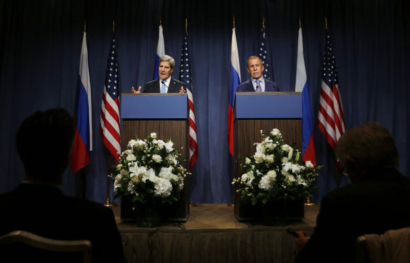 U.S. Secretary of State John Kerry speaks next to Russian Foreign Minister Sergey Lavrov, right, during a press conference before their meeting to discuss the ongoing crisis in Syria, in Geneva, Switzerland, Thursday Sept. 12, 2013. Secretary of State John Kerry and his team have opened two days of meetings with their Russian counterparts in Geneva. Kerry is hoping to come away with the outlines of a plan for securing and destroying vast stockpiles of Syrian chemical weapons. (AP Photo/Larry Downing, Pool)