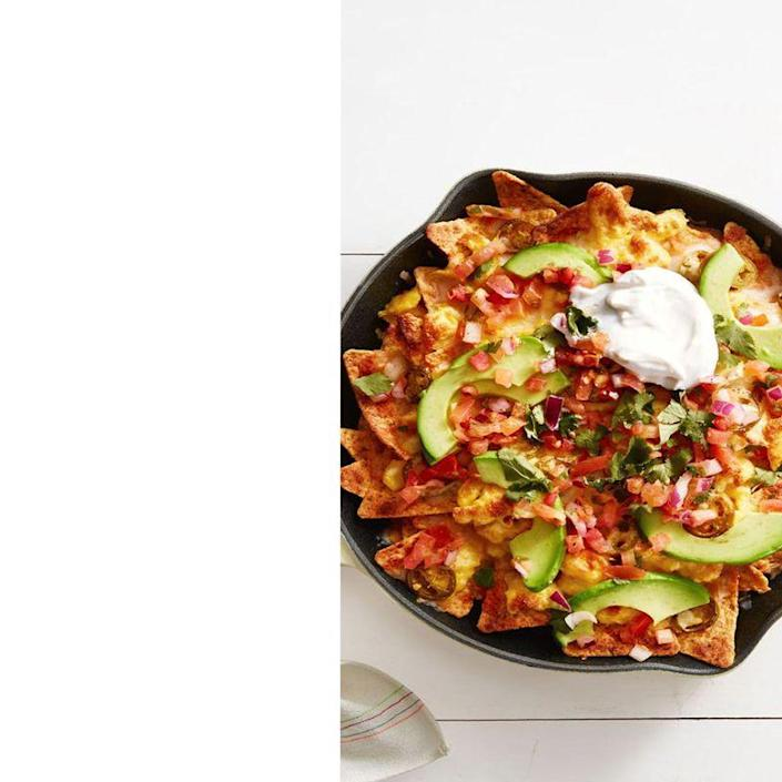 """<p>Considering they're topped with avocado, pico de gallo, lime juice, and (of course) plenty of cheese, Dad is sure to love eating these chilaquiles on Father's Day.</p><p><em><a href=""""https://www.goodhousekeeping.com/food-recipes/a39354/mexican-breakfast-chilaquiles-recipe/"""" rel=""""nofollow noopener"""" target=""""_blank"""" data-ylk=""""slk:Get the Mexican Breakfast Chilaquiles recipe"""" class=""""link rapid-noclick-resp"""">Get the Mexican Breakfast Chilaquiles recipe</a>.</em></p>"""