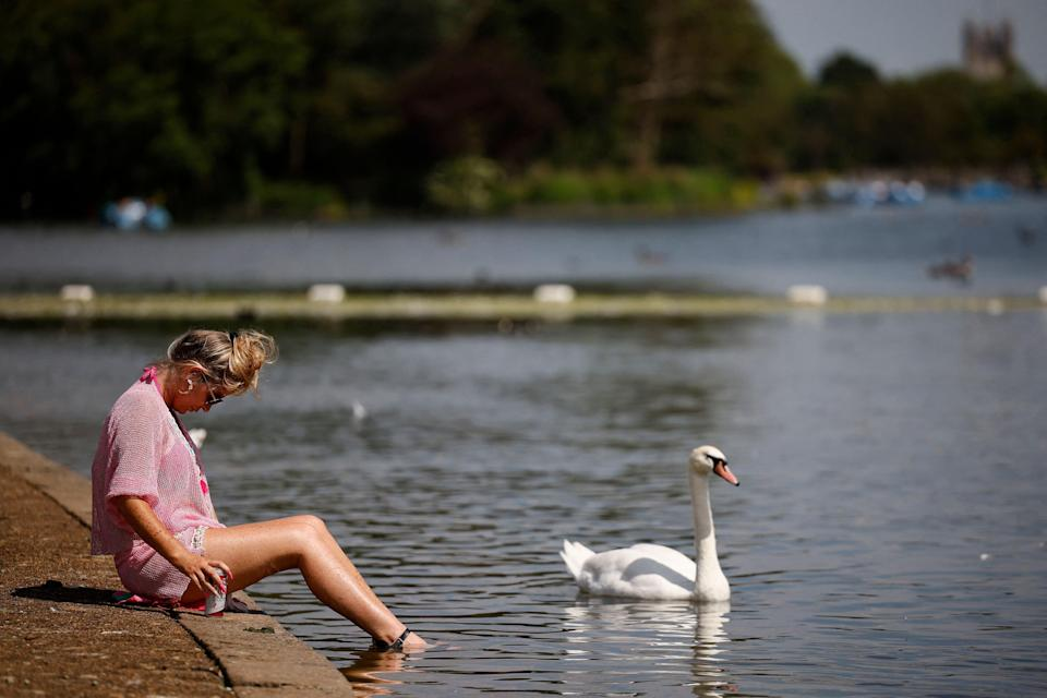 A woman paddles her feet in the Serpentine in Hyde Park (AFP/Getty)