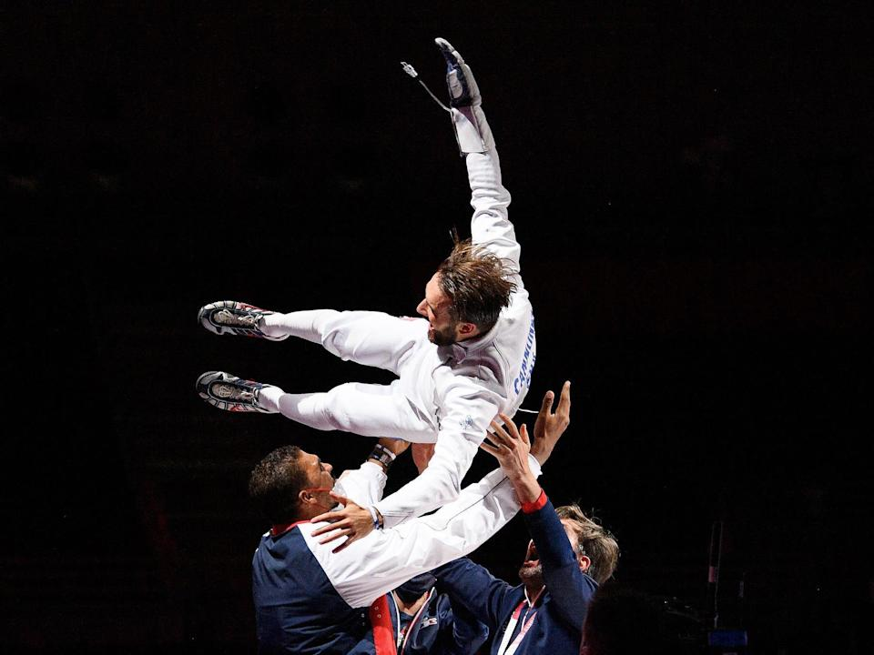 French fencer tossed in air by coaches at the Olympics.