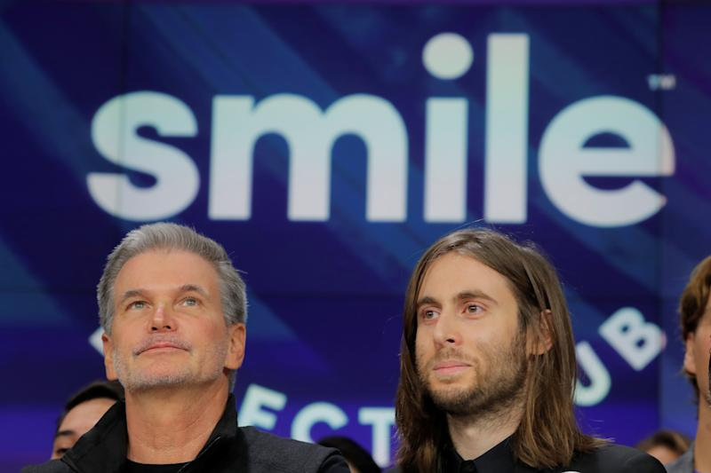 David Katzman, CEO of SmileDirectClub stands with founder Jordan Katzman as the company debuts its IPO at the Nasdaq MarketSite in New York, U.S. September 12, 2019. REUTERS/Lucas Jackson