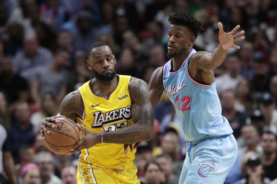 Miami Heat forward Jimmy Butler (22) defends Los Angeles Lakers forward LeBron James in a regular-season game. (AP Photo/Lynne Sladky)