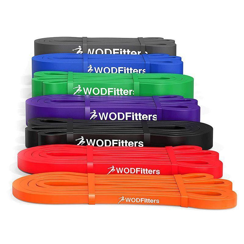 """<p><strong>WODFitters</strong></p><p>amazon.com</p><p><strong>$14.99</strong></p><p><a href=""""https://www.amazon.com/dp/B00IQM3W9K?tag=syn-yahoo-20&ascsubtag=%5Bartid%7C2142.g.36607547%5Bsrc%7Cyahoo-us"""" rel=""""nofollow noopener"""" target=""""_blank"""" data-ylk=""""slk:Shop Now"""" class=""""link rapid-noclick-resp"""">Shop Now</a></p><p>With seven different bands offering seven different resistance levels from 10 to 35 pounds all the way up to 85 to 200, these bands have enough variety for you to find one (or more) that work for your training regimen. Use them in your apartment, stand on them, wrap them around furniture, door handles, or even trees to enable you to perform the exercises in your workout. We used them when traveling and even wrapped them around fences for presses, and car roof racks for pull downs, and had no issues with the bands tearing. They're great to assist with stretching as well. Prices run from $10 to $70, depending on resistance level.</p>"""