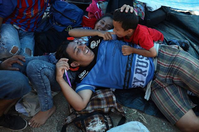 "<p>A Central American migrant family from Honduras participating in the annual Migrant Stations of the Cross caravan or ""Via crucis,"" organized by the ""Pueblo Sin Fronteras"" activist group, joke around as they rest at a sports center during the caravan's few-days stop in Matias Romero, Oaxaca state, Mexico, Monday, April 2, 2018. A Mexican government official said the caravans are tolerated because migrants have a right under Mexican law to request asylum in Mexico or to request a humanitarian visa allowing travel to the U.S. border to seek asylum in the United States. (Photo: Felix Marquez/AP) </p>"