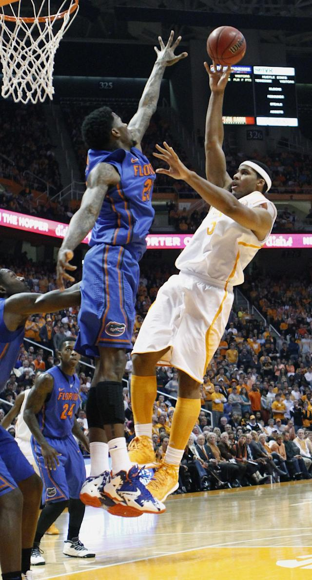 Tennessee forward Jarnell Stokes, right, shoots over Florida forward Casey Prather (24) in the first half of an NCAA college basketball game on Tuesday, Feb. 11, 2014, in Knoxville, Tenn. (AP Photo/Wade Payne)