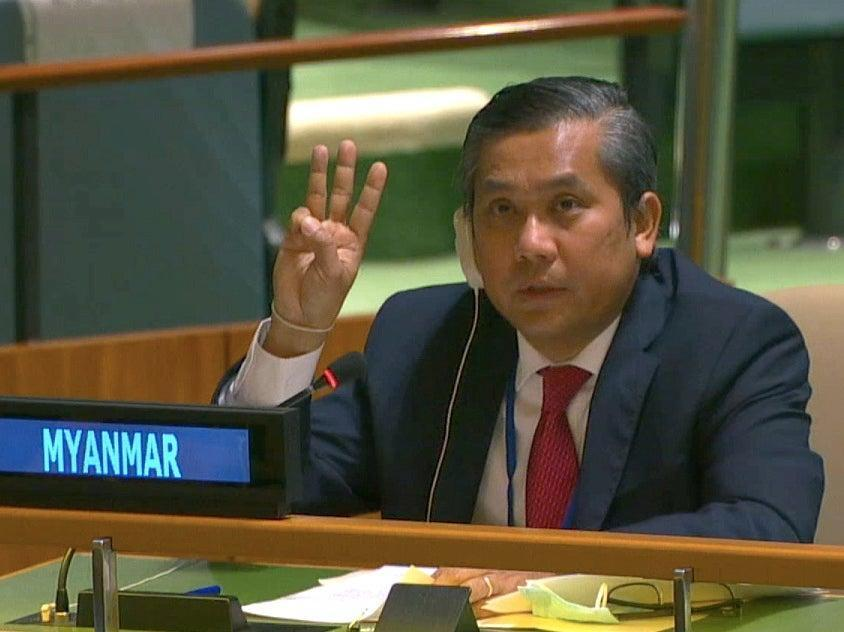 <p>Myanmar's ambassador to the United Nations Kyaw Moe Tun holds up three fingers at the end of his address</p> (Reuters)