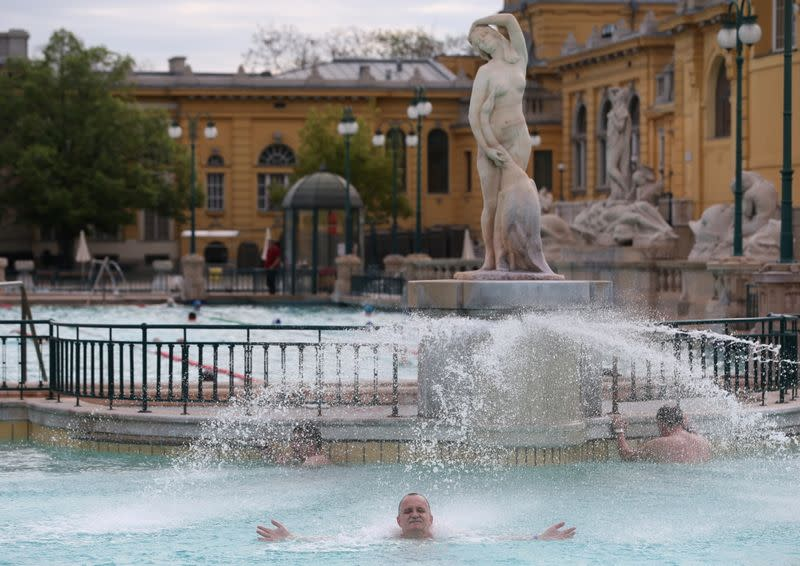 A man relaxes at the Szechenyi thermal bath as the coronavirus disease (COVID-19) restrictions are eased in Budapest