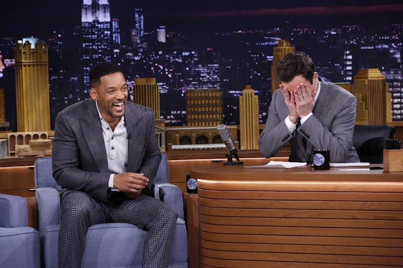 "In this photo provided by NBC, Jimmy Fallon appears with Will Smith, left, during his ""The Tonight Show"" debut on Monday, Feb. 17, 2014, in New York. Fallon departed from the network's ""Late Night"" on Feb. 7, 2014, after five years as host, and is now the host of ""The Tonight Show,"" replacing Jay Leno after 22 years. (AP Photo/NBC, Lloyd Bishop)"