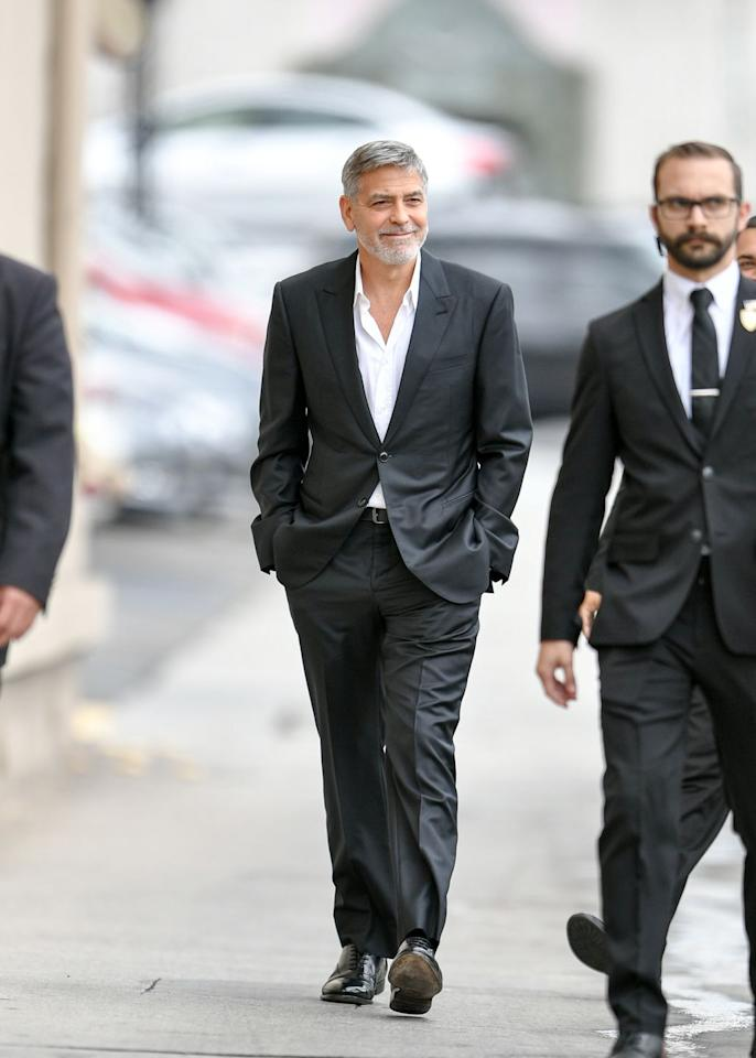 """<p>George Clooney is back on form. Not that he was ever off it. But after debuting <a href=""""https://www.esquire.com/uk/style/a27340517/george-clooney-and-the-art-of-the-perfect-beard-catch-22-new-york/"""" target=""""_blank"""">what may well be the perfect beard</a>, the <em>Catch-22 </em>star returned to pure, unadulterated nineties splendour in a boxy suit sans tie.<em></em></p>"""