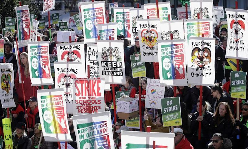 Teachers, students and supporters protest at Frank Ogawa Plaza in front of City Hall in Oakland, California, on 21 February.