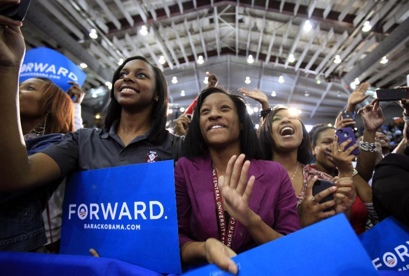 North Carolina Central University students, including Aaliyah McMillan, center, cheer for first lady Michelle Obama as she speaks at the Durham, N.C. school on Wednesday, Sept. 19, 2012. Obama said her husband is fighting to ensure all people have the tools to succeed and live the American dream — comments that drew a contrast with Mitt Romney's divisive words in a secretly recorded speech that rattled his campaign this week. (AP Photo/The News & Observer, Takaaki Iwabu) MANDATORY CREDIT