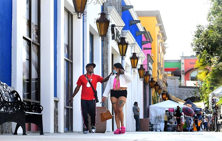 LYNWOOD, CALIFORNIA AUGUST 5, 2020-Customers walk at the Plaza Mexico in Lynwood Wednesday. The neighborhood has become the epicenter for the cornavirus along with Bell, Paramount and South Gate. (Wally Skalij/Los Angeles Times)