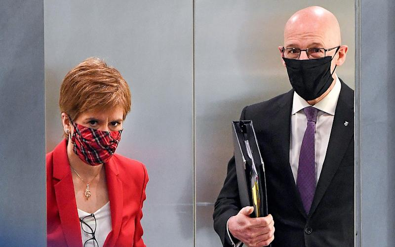 John Swinney, right, admitted contingencies were being looked at - Jeff J Mitchell/Getty