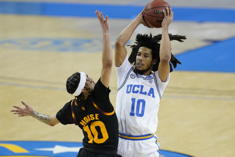 Arizona State guard Jaelen House, left, defends against UCLA guard Tyger Campbell during the second half of an NCAA college basketball game Saturday, Feb. 20, 2021, in Los Angeles. (AP Photo/Ashley Landis)