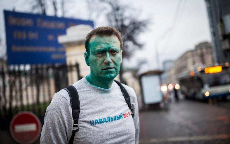 Alexei Navalny after attackers doused him with green antiseptic outside a conference venue in Moscow on April 27 - Credit: Evgeny Feldman/Pool Photo via AP